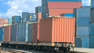 Other Corporate Trust Services.  Rail cargo carts in a cargo yard.