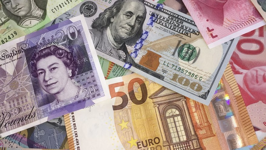 Picture of international currency including yen, euros, dollars, pesos, pound
